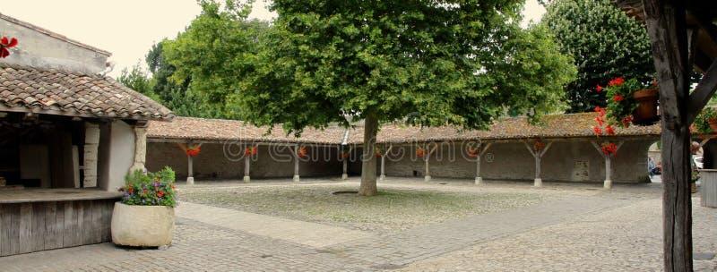 La Flotte empty ancient market in Il de Re, France. Landscape image. Roof tiles and tree stock photos
