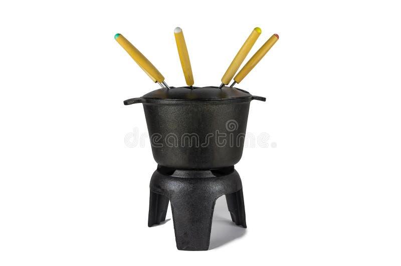La fonte de fondue, noire, avec les fourchettes multicolores photographie stock libre de droits