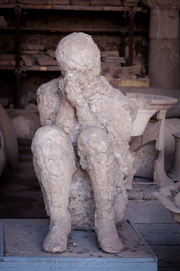 La forma del cittadino da Pompei che ha ottenuto ha intrappolato nelle ceneri immagine stock