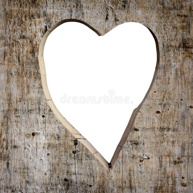 La forma del cuore ha scolpito in una plancia fotografia stock
