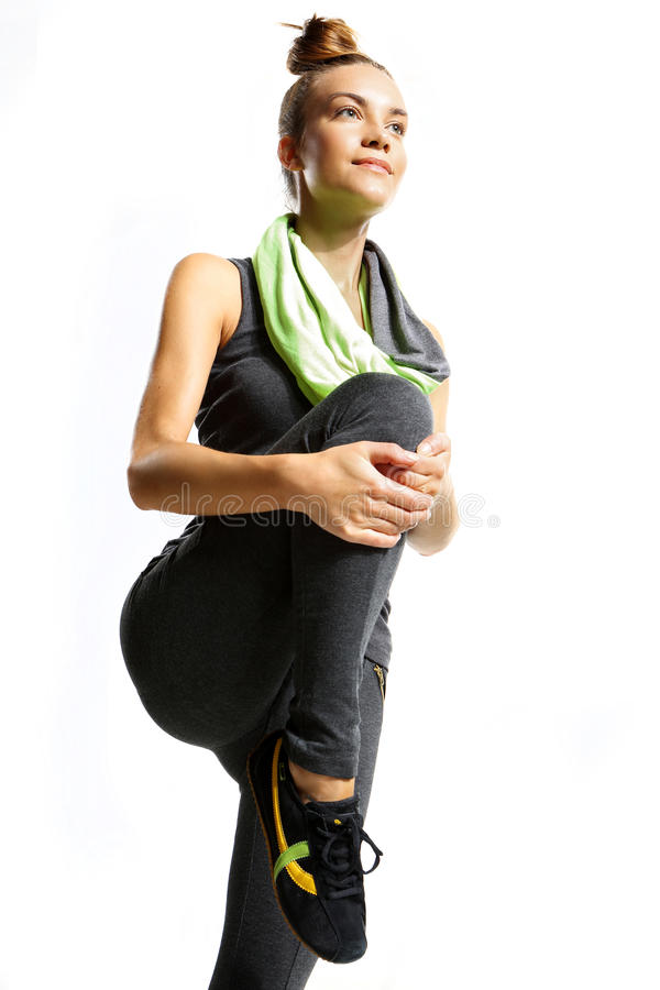 La formation aérobie de fille augmente le genou  image stock