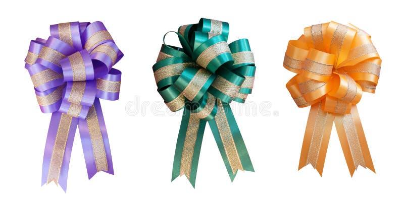 La forme de fleur d'arc de ruban de cadeau a placé la couleur pourpre orange verte d'isolement sur le fond blanc, chemin de coupu images libres de droits