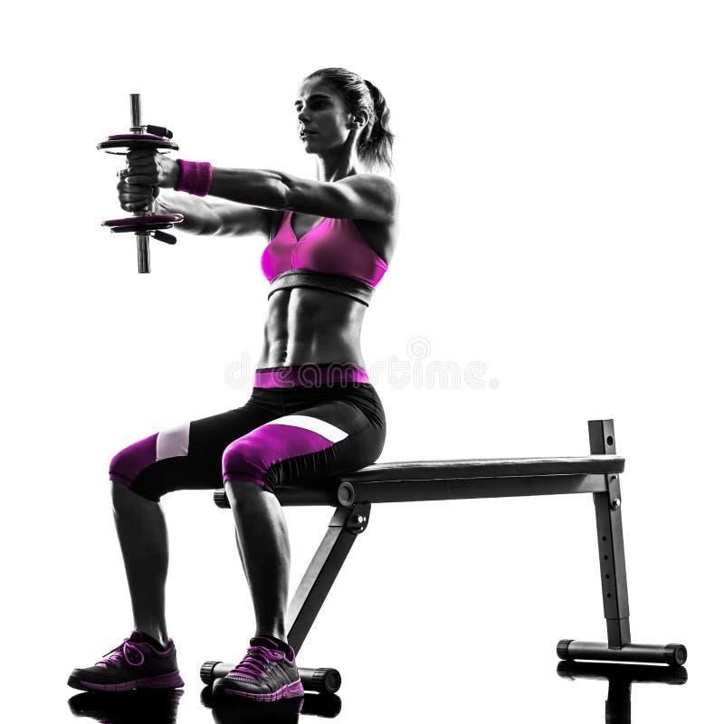 La forme physique de femme exerce la silhouette de poids photo libre de droits