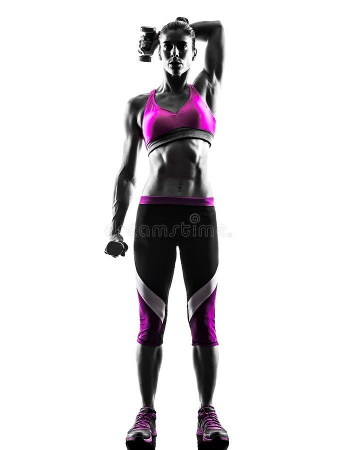 La forme physique de femme pèse la silhouette d'exercices images libres de droits
