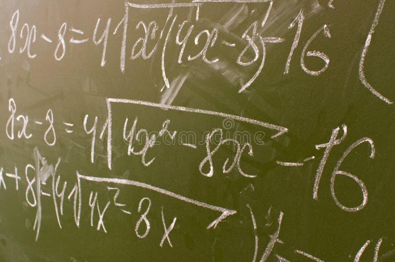 La formule sur un panneau d'école. image stock