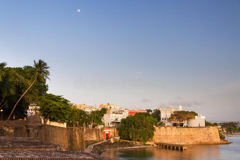 La Fortaleza sunset. Outer wall of San Juan, Puerto Rico, with ancient mansion La Fortaleza on the right, at sunset royalty free stock photos