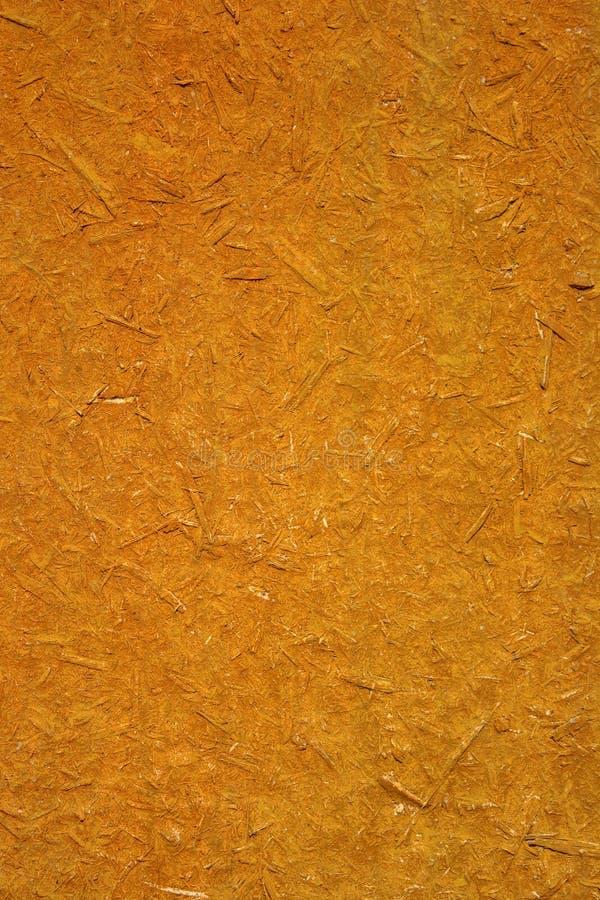 La foto de una vieja textura del tablero de madera consiste en el serrín de madera fotografía de archivo