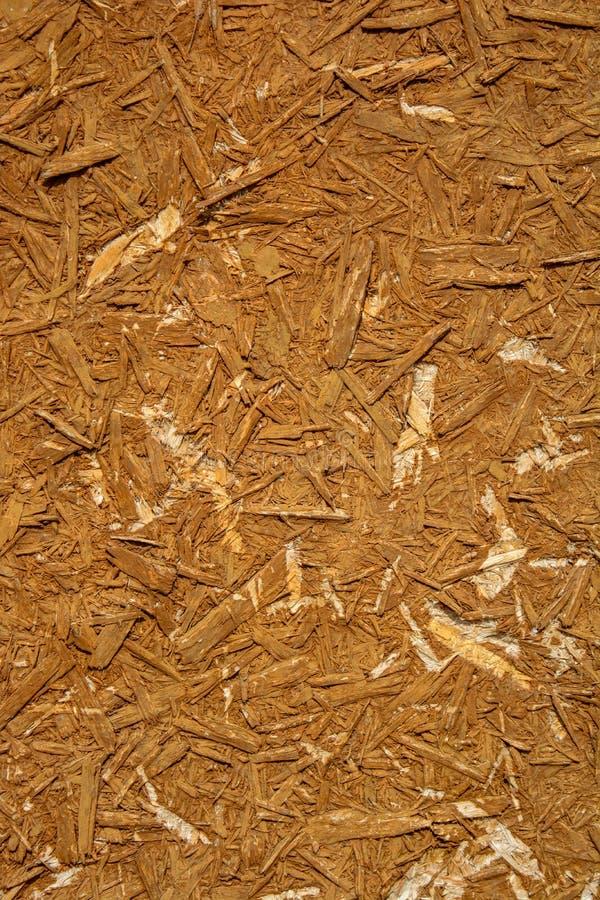 La foto de una vieja textura del tablero de madera consiste en el serrín de madera imagenes de archivo