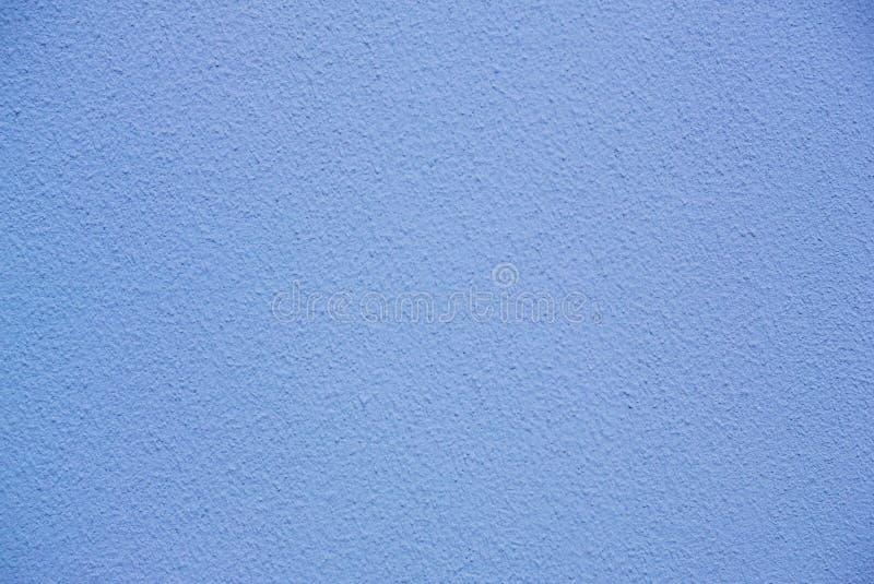 La foto del blu freddo ha colorato la struttura approssimativa della parete dello stucco immagine stock libera da diritti