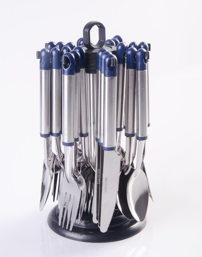 la fourchette, la cuillère et le couteau ont placé sur le fond photographie stock