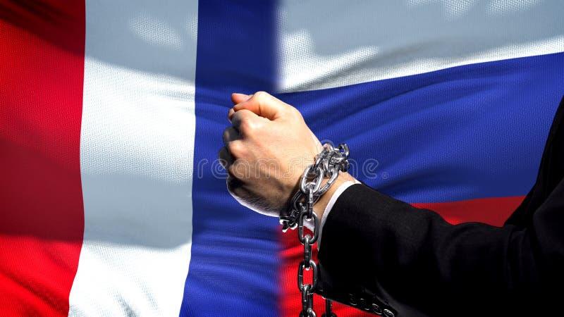 La France sanctionne la Russie, le conflit de bras, politique ou économique enchaîné, interdiction commerciale photographie stock libre de droits
