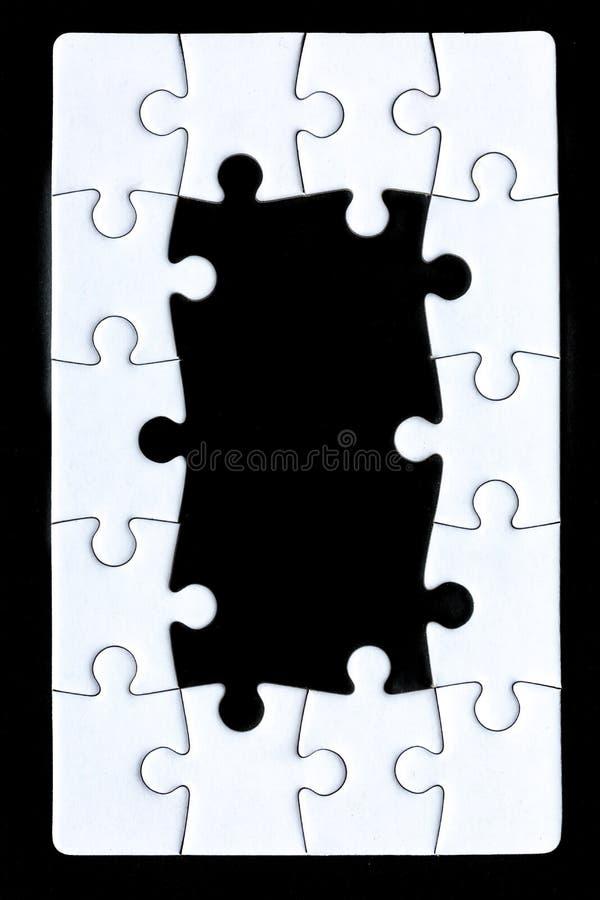 La frontière d'un puzzle photographie stock libre de droits