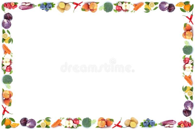 La frutta e le verdure incorniciano i fres dell'arancia della mela isolati copyspace immagini stock libere da diritti
