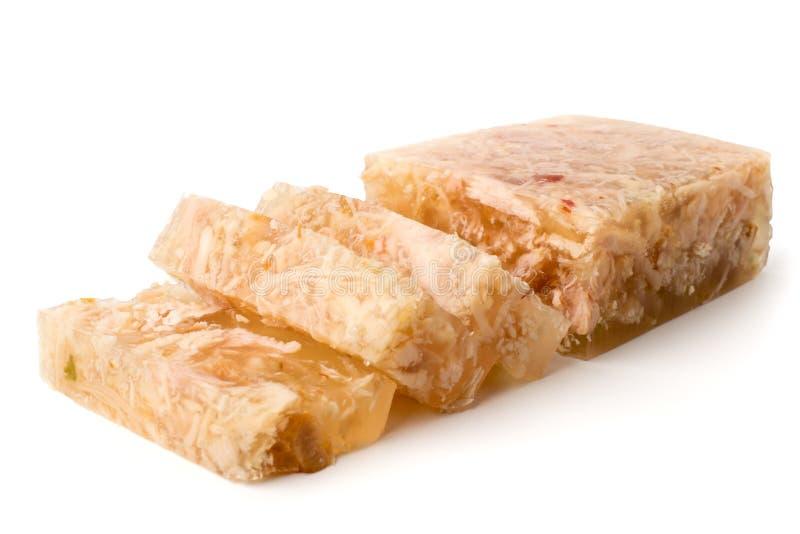 La gelatina della carne ha tagliato nelle fette su un bianco, primo piano immagini stock