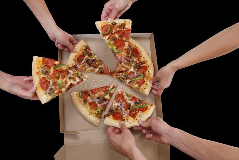 La gente che mangia pizza immagine stock