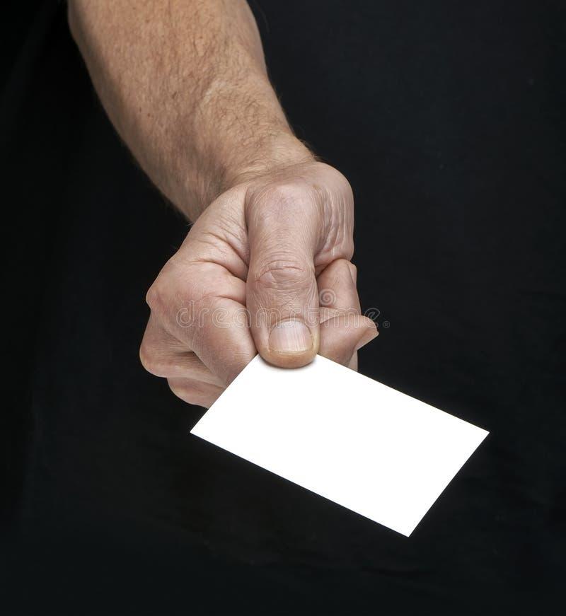 La gente che si incontra per la prima volta, dando una carta immagini stock libere da diritti