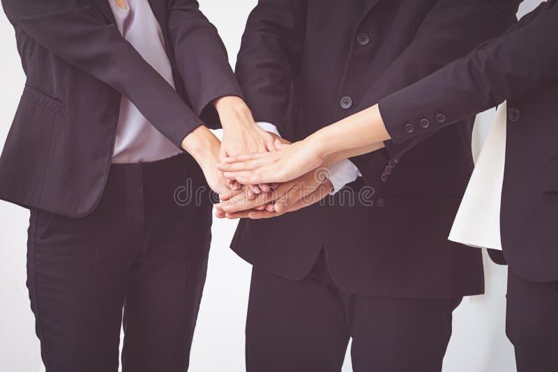 La gente di affari coordina le mani Lavoro di squadra di concetto fotografia stock