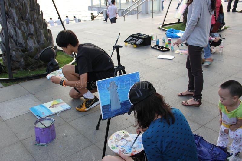 La gente en la pintura en SHENZHEN fotos de archivo