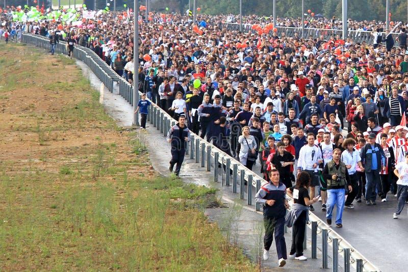 La gente nella maratona immagine stock libera da diritti
