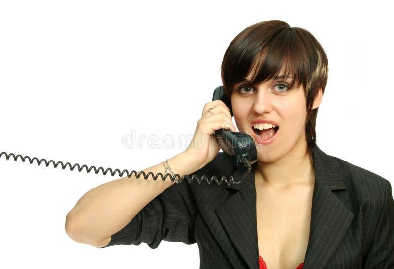 La gentille fille parle par le téléphone image stock