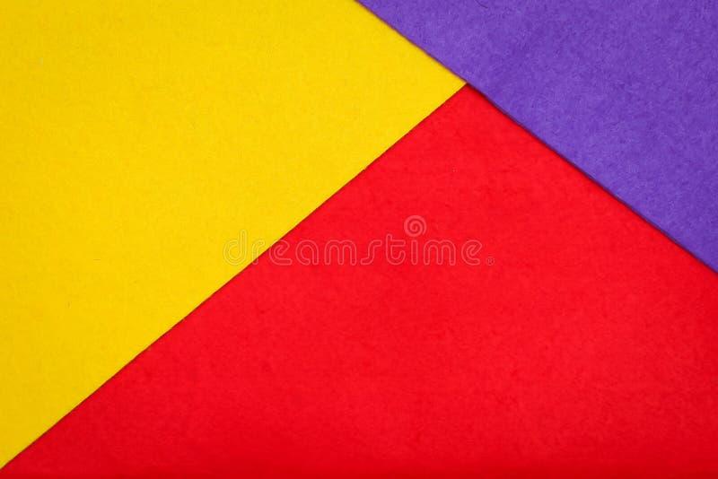 La geometría abstracta coloreó el fondo del minimalismo de la textura del fieltro Formas y líneas geométricas mínimas en colores  imágenes de archivo libres de regalías