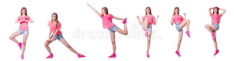 La giovane donna che fa gli esercizi su bianco fotografie stock