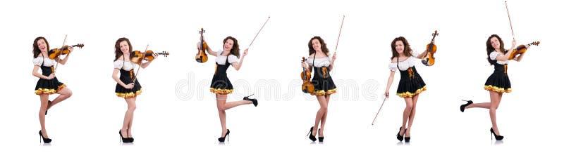 La giovane donna che gioca violino su bianco fotografia stock
