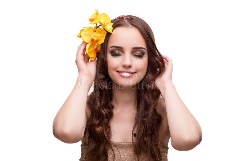 La giovane donna con il fiore dell'orchidea isolato su bianco immagine stock