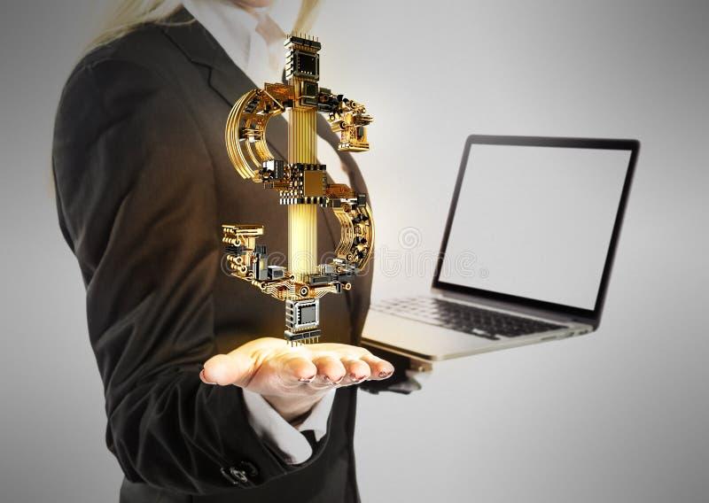 La giovane donna di affari con il computer portatile ed i soldi del dollaro firmano a disposizione fotografie stock