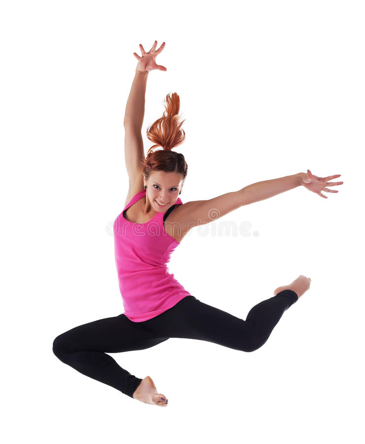 La giovane donna di bellezza salta in costume acrobatico immagini stock libere da diritti