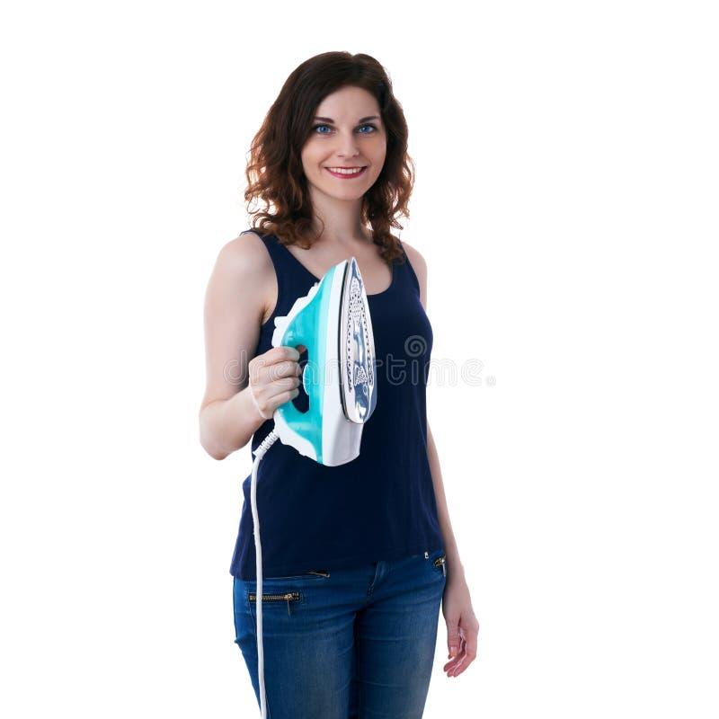 La giovane donna in maglietta scura ed i guanti di gomma verdi sopra bianco hanno isolato il fondo fotografie stock libere da diritti