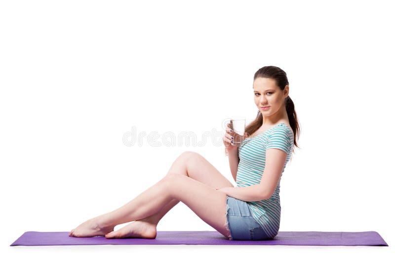 La giovane donna nel concetto di sport isolata sul bianco fotografie stock