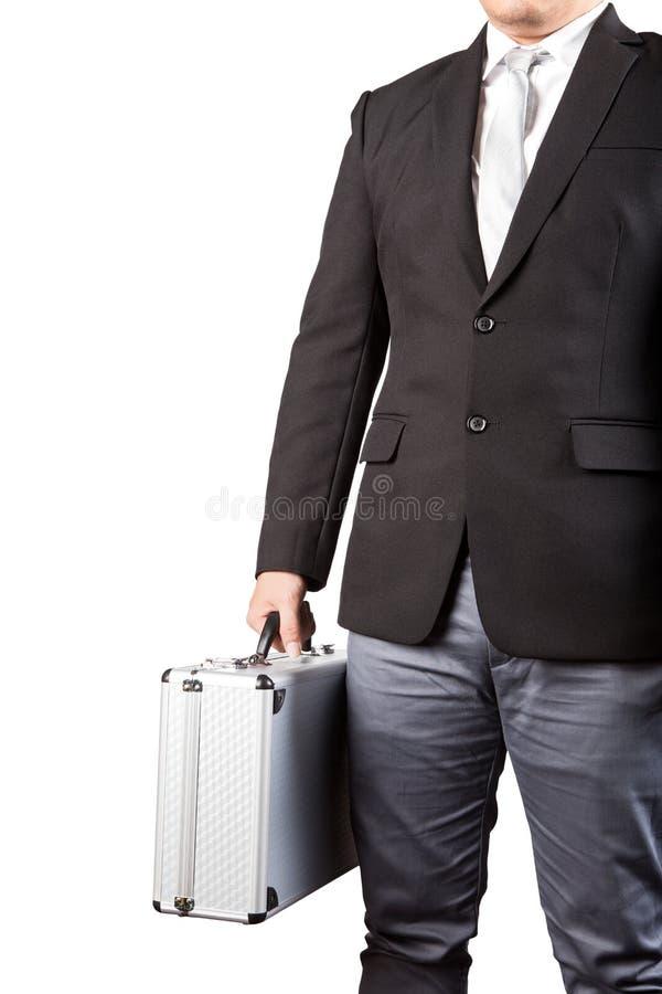 La giovane valigia del metallo dello stong della tenuta dell'uomo di affari ha isolato la b bianca fotografie stock libere da diritti