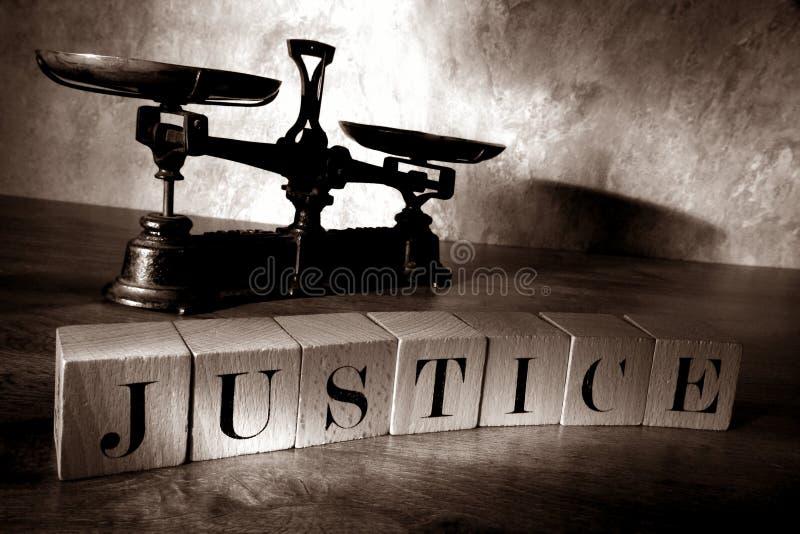 La giustizia di parola ha ortografato con i blocchetti della lettera fotografie stock libere da diritti