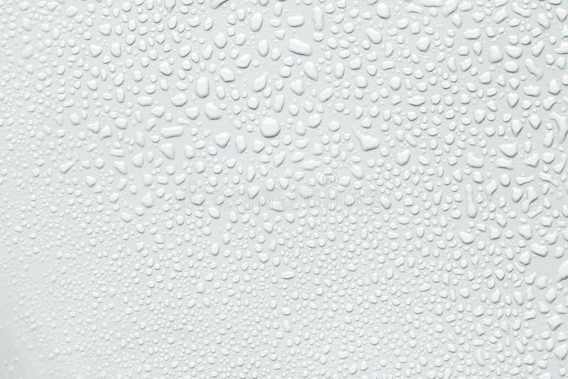 La goccia di acqua astratta su superficie di fondo bianco fresco immagine stock libera da diritti