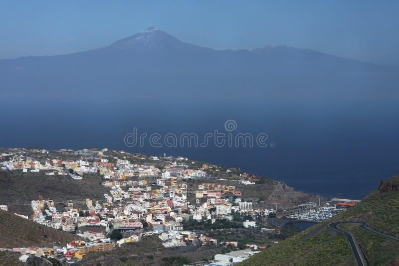 La Gomera coastline. San Sebastian, main city of La Gomera Island, and Teide volcano, on Tenerife island, at the horizon stock photography