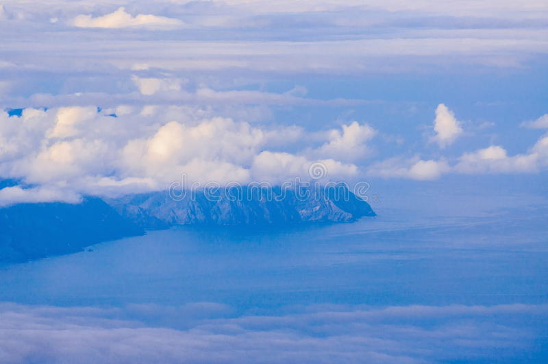 La Gomera island behind the clouds in Tenerife, Spain.  stock image
