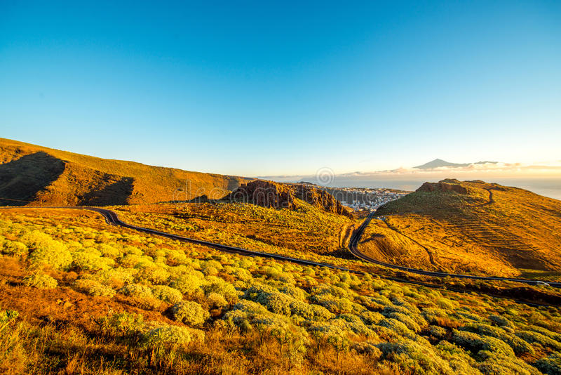 La Gomera island landscape. Landscape view with mountain road near San Sebastian city with Tenerife island on the background in the morning royalty free stock images
