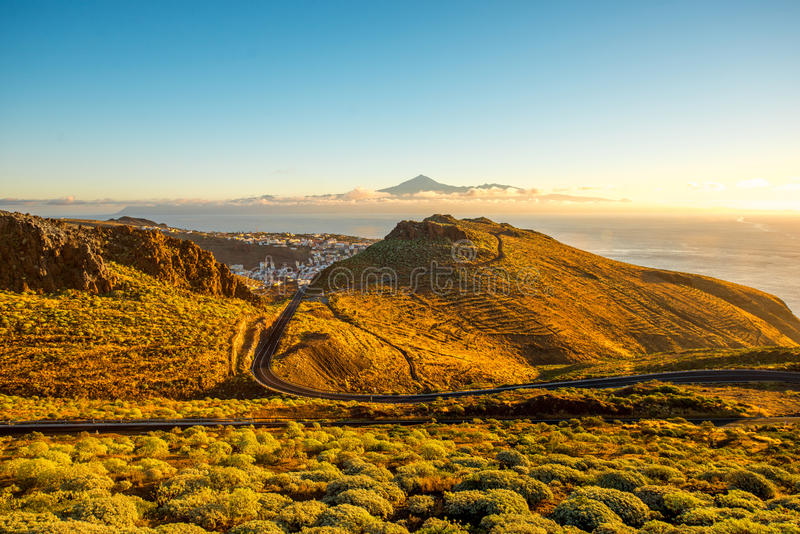 La Gomera island landscape. Landscape view with mountain road near San Sebastian city with Tenerife island on the background in the morning royalty free stock photo
