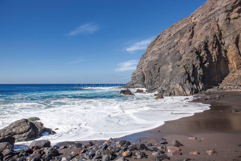 La Gomera - Playa del Trigo. Lonely beach with black sand and impressive rock backdrop at the Playa del Trigo near Alojera in the west of La Gomera, Canary royalty free stock image
