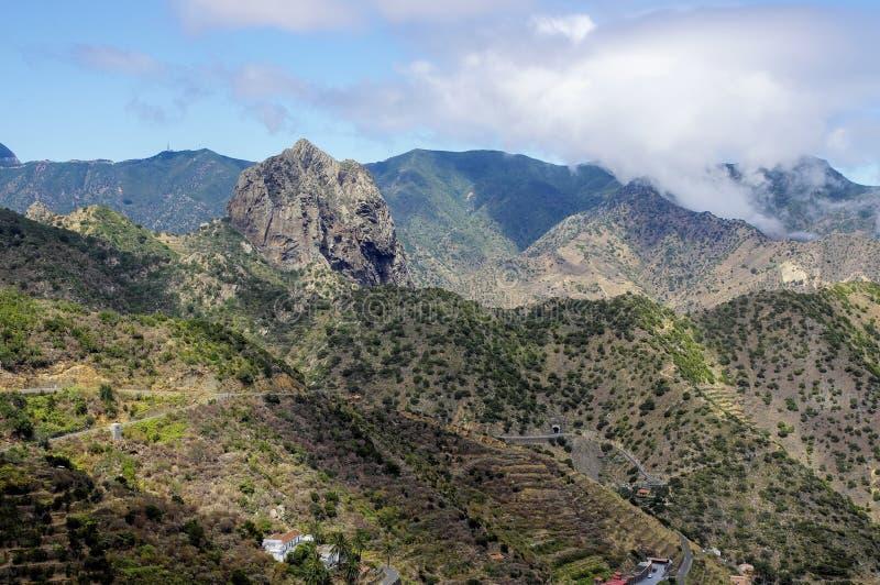 La Gomera - Roque El Cano. Above the town of Vallehermoso. In the background the cloudy Cumbre de Chijere with Buenavista stock image