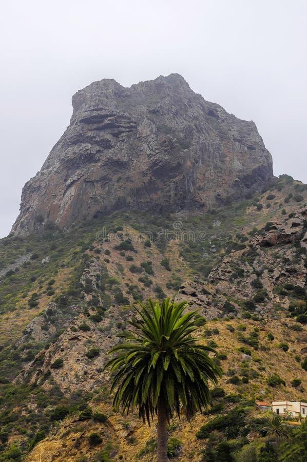 La Gomera - Roque El Cano. Above the town of Vallehermoso. In the background the cloudy Cumbre de Chijere with Buenavista stock photo