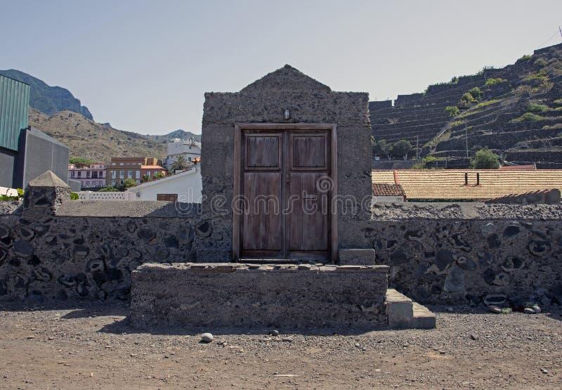 A door to ??? on La Gomera. La Gomera is a Spanish island located in the Atlantic Ocean as part of the Canary Islands. La Gomera is of volcanic origin stock image