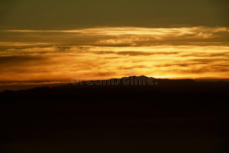 La Gomera in the sun down. Silhouette of La Gomera under the yellow evening sun royalty free stock photo
