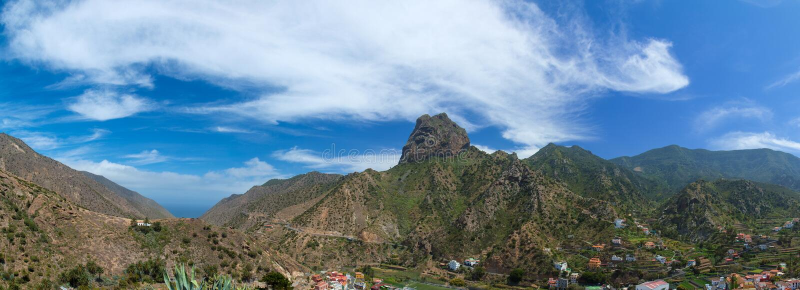 La Gomera, Vallehermoso. Volcanic plug Roque Cano over the village stock image