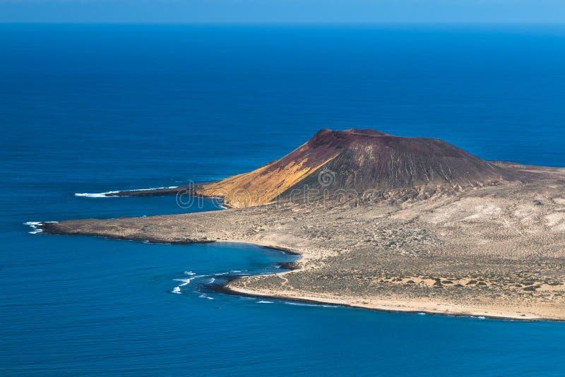 La Graciosa Volcano View In Lanzarote, Spain. View from the Mirador del Rio in Lanzarote, Spain to the Isla La Graciosa with the volcano Montana Amarilla, the stock images
