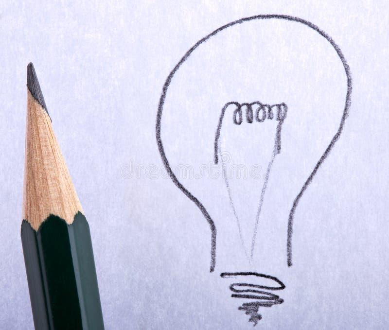 La grande idée, ampoule avec le crayon lecteur photo stock