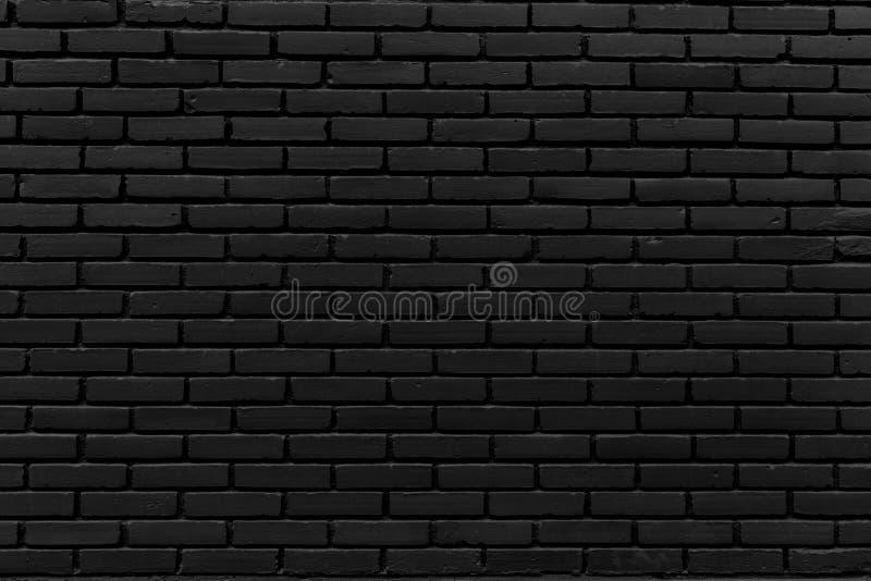 La grande parete nera dal mattone fotografie stock
