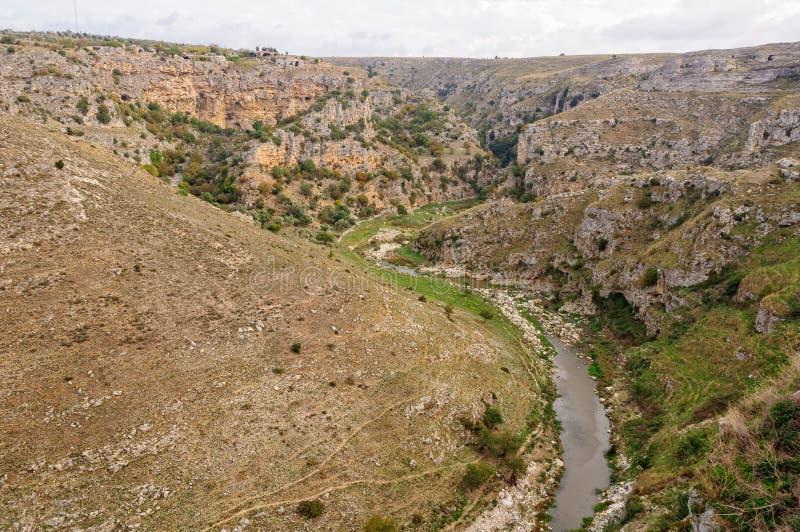 La Gravina - Matera. The deep curving gorge of the Gravina di Matera river - Matera, Basilicata, Italy stock images