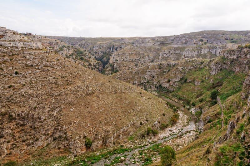 La Gravina - Matera. The deep curving gorge of the Gravina di Matera river - Matera, Basilicata, Italy royalty free stock photo